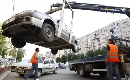 Ridicarea masinilor de pe marile bulevarde, ILEGALA!