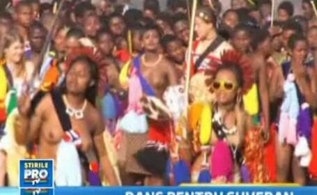 Dansul fecioarelor in sanii goi. Regele din Swaziland isi alege nevasta noua. Pana acum are 13.VIDEO