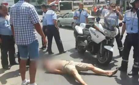 Un barbat a provocat un adevarat circ in Bucuresti. S-a asezat pe linie, a vandalizat o masina si s-a batut cu politistii