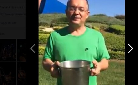 Emil Boc a acceptat provocarea si si-a turnat o galeata cu apa pe cap. Primarul a provocat-o pe Elena Udrea. VIDEO