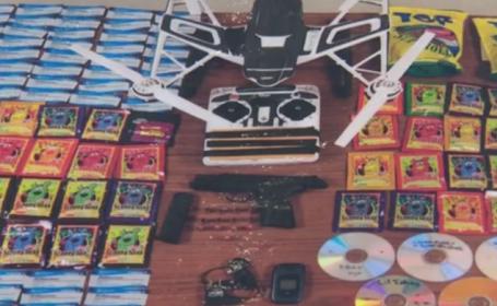 Droguri, arme si filme pentru adulti, gasite intr-o drona pe care cativa detinuti au incercat sa o introduca in inchisoare