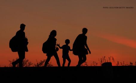 familie de refugiati la granita cu Ungaria