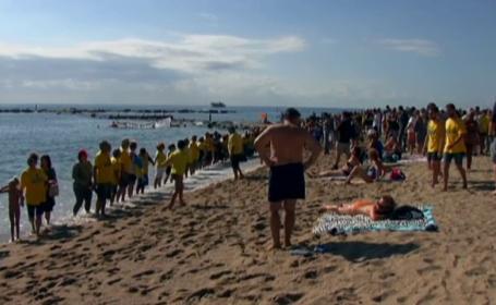 Proteste pe o plajă din Barcelona