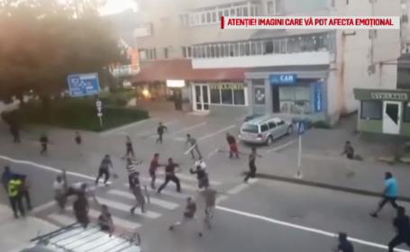 Bătaie cu răngi și topoare pe o stradă din Vaslui. Au fost trase și focuri de armă. VIDEO