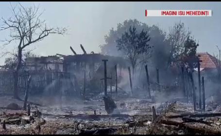 Dezastru provocat de o bătrână care a vrut să ardă vegetaţia din curte