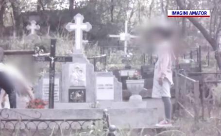 O femeie din Iași fura flori din cimitire, cu ajutorul fiicei de aproape 10 ani
