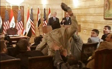Bush atacat cu pantofi