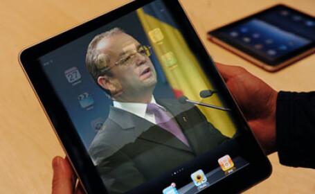 Emil Boc e dependent de iPad si ar vrea ca tableta sa aiba si functia \