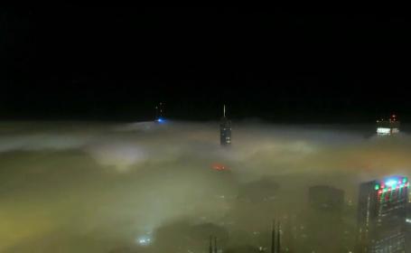 Imagini spectaculoase surprinse de o camera de supraveghere in Chicago. Orasul pare desprins dintr-un film de groaza