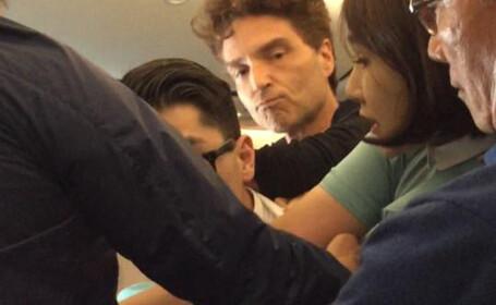 Un pasager violent dintr-un avion coreean a fost legat si pazit de 2 vedete. \