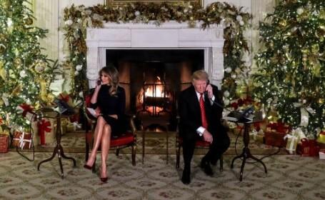 Donald şi Melania Trump, în rolul de mesageri ai lui Moş Crăciun