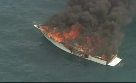 Un iaht cu 5 adulţi şi un copil la bord a luat foc în larg
