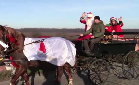 Moș Crăciun a ajuns mai devreme într-o localitate din Dâmbovița. Reacția celor mici