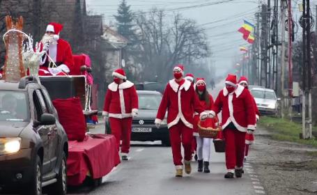 Peste 5.000 de daruri dulci, împărțite de Moș Crăciun tuturor localnicilor din comuna Livezile