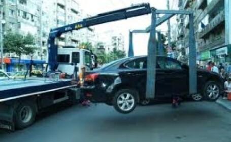 Situatie comica la Timisoara: masina ridicata cu tot cu un copil inauntru