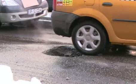 masina trece prin gropi