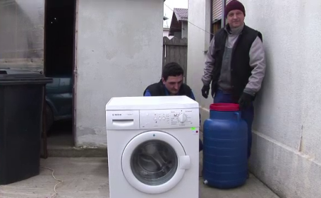 masina de spalat cu alimentare din butoi