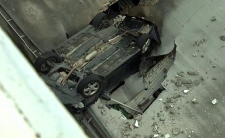 A incurcat frana cu acceleratia si a cazut de pe o parcare supraetajata pe acoperisul unui magazin. Soferul a supravietuit