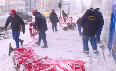 Cum se descurcă românii nevoiţi să stea 12 ore în frig din cauza muncii lor