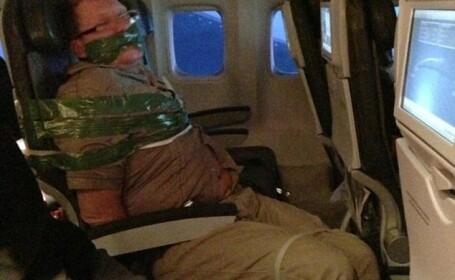 Un pasager american a zburat legat de scaun pentru ca era prea violent, din cauza alcoolului
