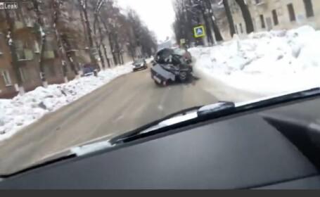 Cu masina facuta praf si cu un prieten mort pe bancheta din spate, un sofer rus a pornit la drum