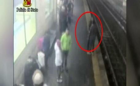 Momentul in care un politist salveaza o femeie din fata trenului in Italia. Tanara a vrut sa se sinucida din cauza iubitului