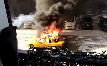 Scene de cosmar intr-un oras din SUA. Un taximetrist si-a salvat la limita pasagerul, dupa ce masina a luat foc