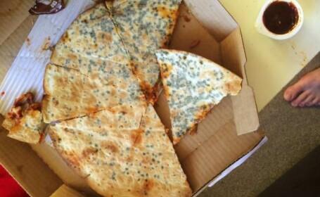 Un barbat din Marea Britanie a avut parte de o surpriza neplacuta cand a deschis o cutie de pizza de la un celebru lant