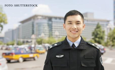 Un escroc din China si-a facut sectie de politie in apartament si s-a dat drept agent. Cum a fost prins in final