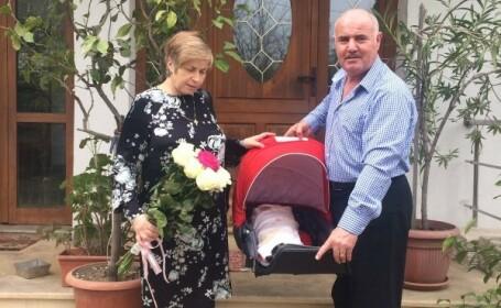 Parintii arhitectului Andrei Buca, mort in incendiul din Colectiv, si-au botezat fetita de 3 luni. \