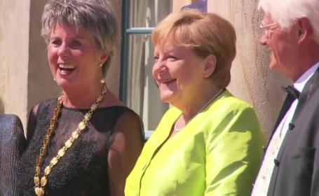 Apariție surprinzătoare a Angelei Merkel, pe covorul roșu