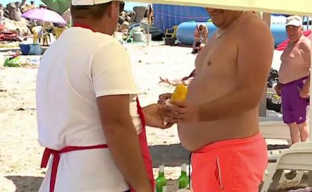 Vânzător ambulant, pe plajă