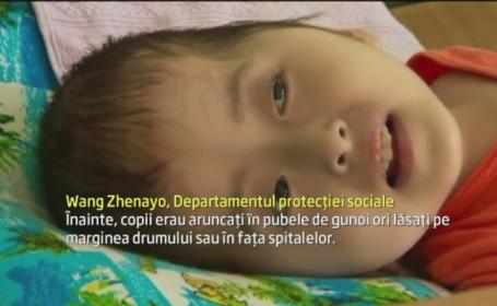 Fenomenul pseudo-orfanilor. Tara care lupta sa devina cea mai puternica economie a lumii isi abandoneaza copiii bolnavi