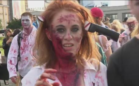Parada cu zombie in Polonia. Participantii s-au deghizat atat de bine incat i-au bagat in sperieti pe trecatori