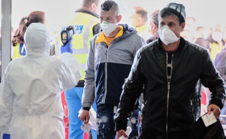 Alți zeci de români infectați cu coronavirus la un abator din Germania. Care este starea lor