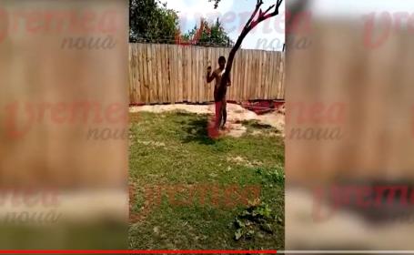 Scene inumane în Vaslui: o mamă și-a legat cu lanțul fiul de un copac