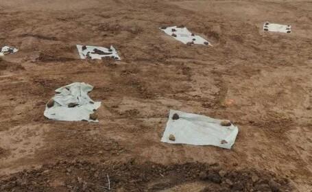 Mai multe gropi cu oseminte au fost descoperite pe şantierul drumului expres Craiova-Piteşti (Video)