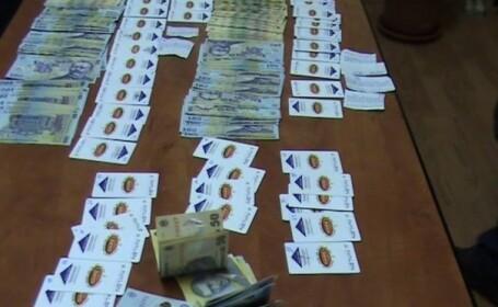 Retea de falsificatori de bani, prinsa la Arad