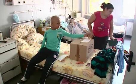 Cum il puteti ajuta pe Ionut Vintila, orfanul bolnav de cancer, cu un brat amputat