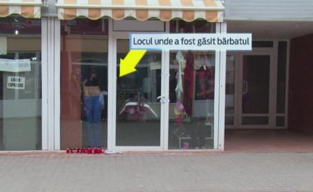 Descoperire sinistra intr-un magazin din Dambovita. Un barbat a fost gasit spanzurat, in vitrina unui magazin