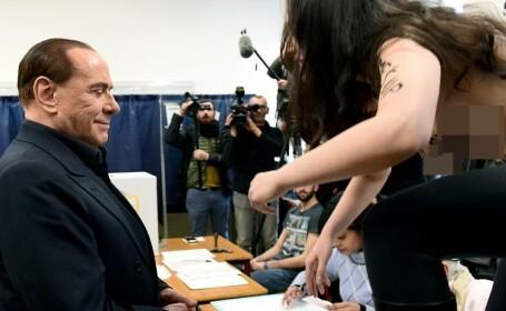 protest topless Berlusconi