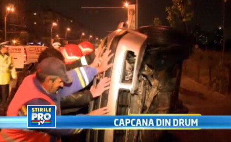 BORDURA-capcana din drum. O soferita s-a rasturnat cu masina in mijlocul unui bulevard din Bucuresti