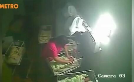 Atentie, imagini socante. Asistenta medicala, filmata in timp ce batea si musca o fetita de numai patru zile. VIDEO