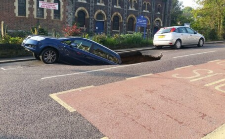 crater in asfalt, Londra