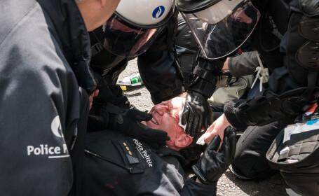 Confruntari violente in Bruxelles. Seful politiei, ranit dupa ce protestatarii au aruncat cu pietre in fortele de ordine