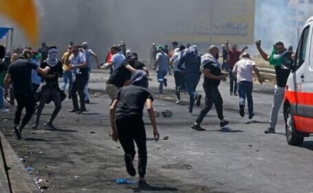 """Confruntările israeliano-palestiniene fac victime și în Cisiordania. Netanyahu anunță că """"încă nu s-a terminat"""""""