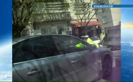 Doi ani de inchisoare, cu executare, pentru soferul care a luat pe capota masinii un politist