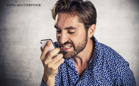 barbat care ameninta la telefon