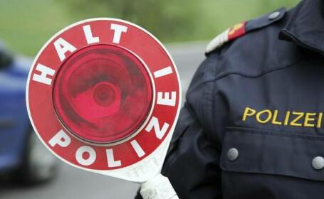 Câți bani au făcut doi români care se dădeau drept polițiști rutieri în Austria