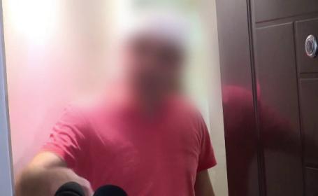 politist care s-a luat cu un vecin la bataie